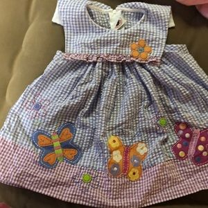Baby girls dress. Gingham pattern